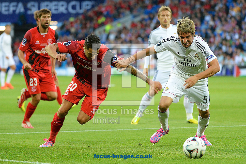 F&aacute;bio Coentr&atilde;o of Real Madrid (right) holds off Vitolo of Sevilla during the European Super Cup match at the Cardiff City Stadium, Cardiff<br /> Picture by Ian Wadkins/Focus Images Ltd +44 7877 568959<br /> 12/08/2014
