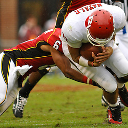 Sep 26, 2009; College Park, MD, USA; Maryland defensive back Anthony Wiseman (6) tackles Rutgers quarterback Domenic Natale (11) during the first half of Rutgers' 34-13 victory over Maryland in NCAA college football at Byrd Stadium.