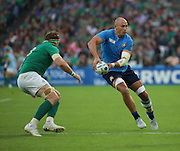 Italy's back row and Captain Sergio Parisse with an offload before getting tackled during the Rugby World Cup Pool D match between Ireland and Italy at the Queen Elizabeth II Olympic Park, London, United Kingdom on 4 October 2015. Photo by Matthew Redman.
