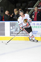 KELOWNA, CANADA - NOVEMBER 4:  Josh Hanson #4 of the Portland Winterhawks skates on the ice against the Kelowna Rockets at Prospera Place on November 4, 2011 (Photo by Marissa Baecker/Shoot the Breeze) *** Local Caption ***Josh Hanson;