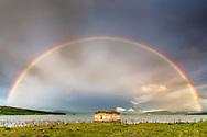 Full rainbow at sunrise
