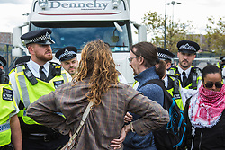 London, UK. 7 September, 2019. Activists block the road in front of a truck attempting to deliver to ExCel London during the sixth day of Stop The Arms Fair protests against DSEI, the world's largest arms fair. The sixth day of protests was billed as a Festival of Resistance and included performances, entertainment for children and workshops as well as activities intended to disrupt deliveries to ExCel London for the arms fair.