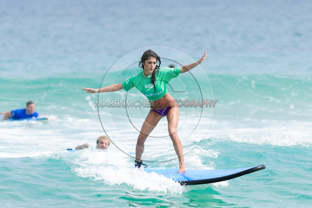 SYDNEY, AUSTRALIA, FEBRUARY 25, 2011: UFC octagon girl Arianny Celeste rides the surf on Bondi Beach in Sydney, Australia on February 25, 2011.