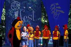 Stock photo of young school children making a  presentation at the International Festival in downtown Houston Texas