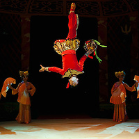 """LONDON, ENGLAND - DECEMBER 16:  Members of the Chinese State Circus perform at a photocall on December 16, 2009 in London, England. The Chinese State Circus today unveiled their new acrobatic spectacular  """"Mulan""""  featuring the Shaolin Warriors .  (Photo by Marco Secchi/Getty Images)"""