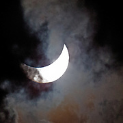 The partial eclipse lights up the clouds, Australia, 14 November 2012