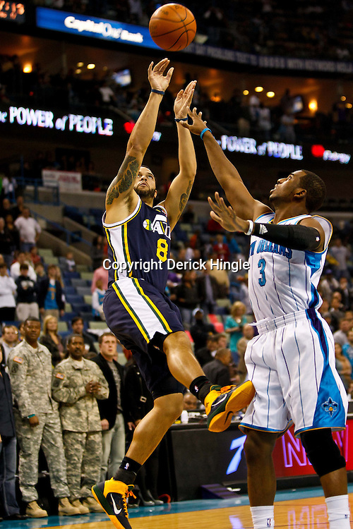 December 17, 2010; New Orleans, LA, USA; Utah Jazz point guard Deron Williams (8) shoots over New Orleans Hornets point guard Chris Paul (3) during the first half at the New Orleans Arena.  Mandatory Credit: Derick E. Hingle