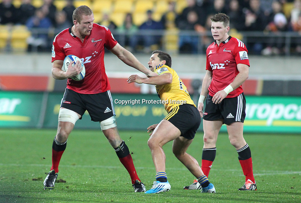 Hurricanes' Tim Bateman squares up with Crusaders' Dominic Bird as Colin Slade watches on during the Round 17 Super Rugby match, between the Hurricanes & Crusaders. Westpac Stadium, Wellington. 28 June 2014. Photo.: Grant Down / www.photosport.co.nz