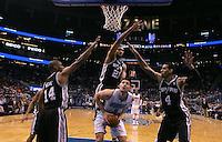 Nov 28, 2012; Orlando, FL, USA; Orlando Magic center Nikola Vucevic (9) attempts to make a shot as San Antonio Spurs point guard Gary Neal (14), power forward Tim Duncan (21) and shooting guard Danny Green (4) defend during the third quarter at Amway Center. San Antonio defeated Orlando 110-89.