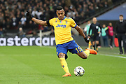 Juventus defender Alex Sandro (12) crossing the ball during the Champions League match between Tottenham Hotspur and Juventus FC at Wembley Stadium, London, England on 7 March 2018. Picture by Matthew Redman.