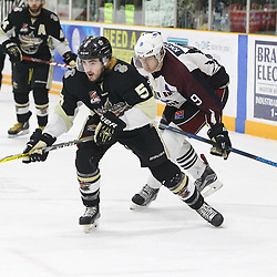 TRENTON, ON  - MAY 4,  2017: Canadian Junior Hockey League, Central Canadian Jr. &quot;A&quot; Championship. The Dudley Hewitt Cup. Game 6 between Trenton Golden Hawks and the Dryden GM Ice Dogs. Bryce Martin #5 of the Trenton Golden Hawks and  Tristan Knott #9 of the Dryden GM Ice Dogs follows the play during the second period.<br /> (Photo by Tim Bates / OJHL Images)