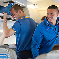 Rosenborg v St Johnstone....17.07.13  UEFA Europa League Qualifier.<br /> St Johnstone Captain Dave Mackay pictured on the flight over to Trondheim as Gary Miller squeezes past him<br /> Picture by Graeme Hart.<br /> Copyright Perthshire Picture Agency<br /> Tel: 01738 623350  Mobile: 07990 594431