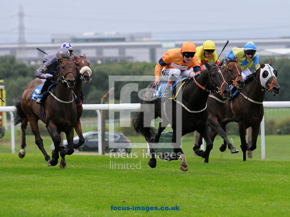 Picture by Alan Wright/Focus Images Ltd 07733 196489<br /> 19/09/2013<br /> Satanic Beat and jockey Tom Queally (orange colours) win The Rifles Challenge Handicap Stakes (div2) at Pontefract Racecourse, Pontefract.