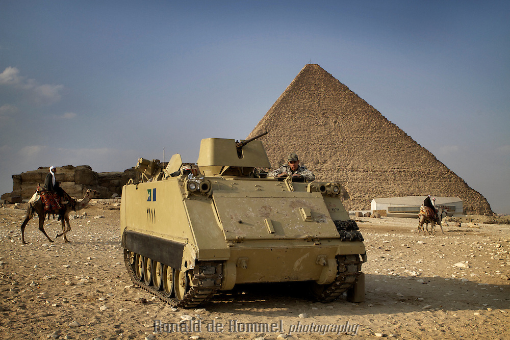 An armoured personnel carrier in front of the pyramids in Giza. Since the 25th of January revolution a lot of police has disappeared from public view. The army's presence is obvious though.