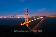 Golden Gate Bridge in San Francisco, California lit up at night.
