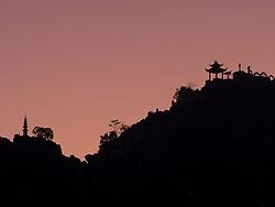 Asia, Vietnam, Ninh Binh, Hang Mua Temple on mountain in silhouette.