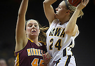 February 18, 2010: Iowa guard Jaime Printy (24) drives to the basket against Minnesota forward Jackie Voigt (45) during the second half of the NCAA women's basketball game at Carver-Hawkeye Arena in Iowa City, Iowa on February 18, 2010. Iowa defeated Minnesota 75-54.