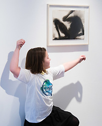 Christies, St James, London, March 4th 2016. Nine year-old Ashley Hubbard from Charlton Manor Primary School mimics the shadowy shapes in  Sir Anthony Gormley's &quot;Wound&quot; from 2014, at the preview for the It&rsquo;s Our World charity auction at Christie's. Over 40 leading artists including David Hockney, Sir Antony Gormley, David Nash, Sir Peter Blake, Yinka Shonibare, Sir Quentin Blake, Emily Young and Maggi Hambling have committed artworks to the It&rsquo;s Our World Auction in support of The Big Draw and Jupiter Artland Foundation, to be sold at Christie&rsquo;s London on 10 March 2016.<br />  ///FOR LICENCING CONTACT: paul@pauldaveycreative.co.uk TEL:+44 (0) 7966 016 296 or +44 (0) 20 8969 6875. &copy;2015 Paul R Davey. All rights reserved.
