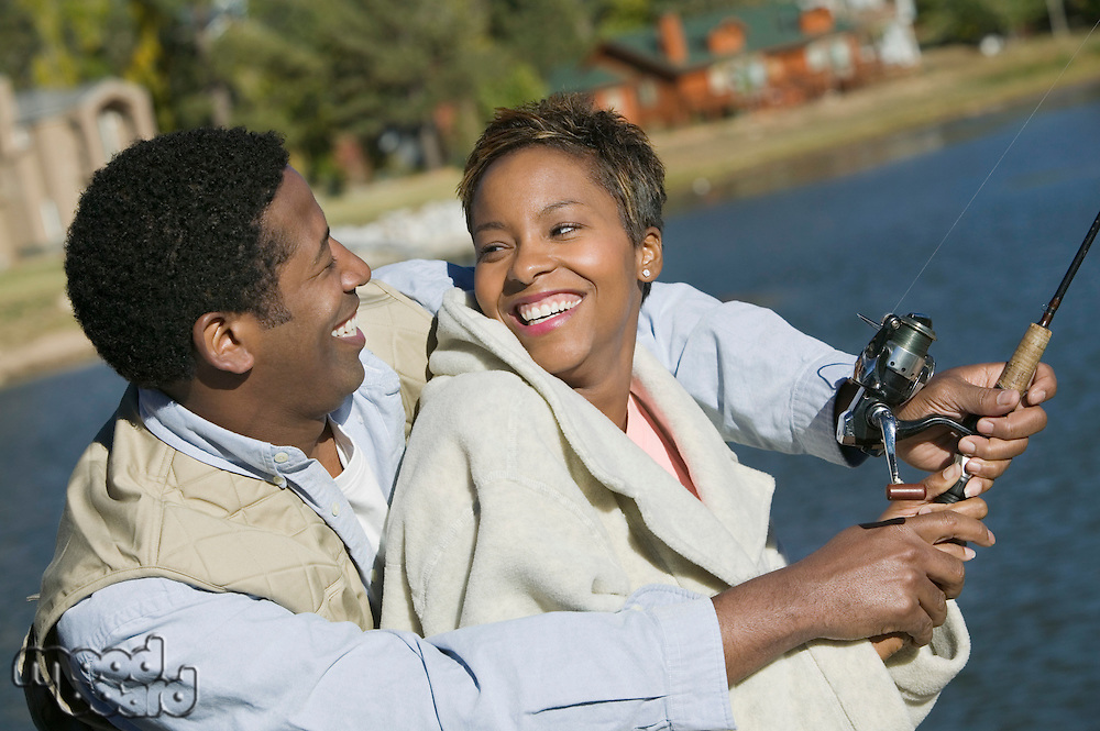Smiling Couple Fishing Together