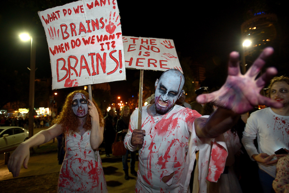 TEL AVIV, ISRAEL - MAR 15, 2014: Israelis wearing zombie make-up and costumes participate the Zombie Walk during the Purim festival in Tel Aviv. The Zombie Walk is held in tel Aviv during Purim Holiday in which Jewish traditionaly wear costumes. Photo by Gili Yaari