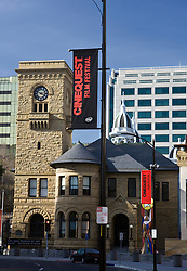 Historic wing of the San Jose Art Museum, formerly the post office, with lamppost signs for the Cinequest Film Festival, San Jose, California, United States of America.
