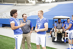 Kentucky quarterback Reese Phillips, left, talks with quarterback Drew Barker, left, and Josh Estes-Waugh during the University of Kentucky's annual football media day, Friday, Aug. 07, 2015 at Commonwealth Stadium in Lexington.