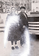 senior couple with photo surface light reflection France ca 1940s