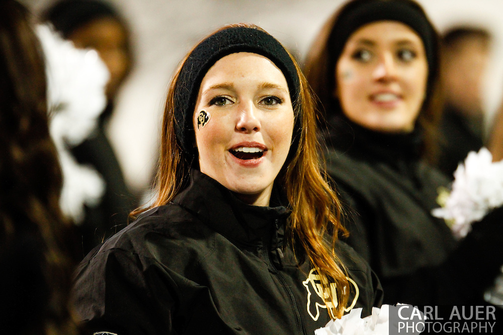 November 23rd, 2013:  A Colorado Cheerleader prior to kick off of the second half of the NCAA Football game between the University of Southern California Trojans and the University of Colorado Buffaloes at Folsom Field in Boulder, Colorado