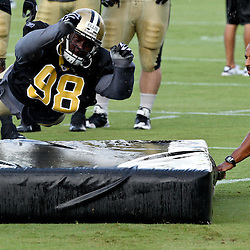 August 9, 2011; Metairie, LA, USA; New Orleans Saints defensive tackle Sedrick Ellis (98) in a tackling drill  in a rain storm during training camp practice at the New Orleans Saints practice facility. Mandatory Credit: Derick E. Hingle