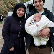 Greece with Doctors of the World (Medecins du monde). Chios Island, one of the places where refugees from Turkey land en route to Northern Europe. Souda camp. A young baby, mother and uncle.