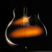 Guitar with soft glowing highlights.