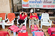 """Apr. 1, 2010 - BANGKOK, THAILAND: A couple sleeps in chairs along the street Democracy Monument and Phan Fa Bridge in Bangkok during the Red Shirt protest Thursday. Fewer than 5,000 """"Red Shirts,"""" members of the UDD (National United Front of Democracy Against Dictatorship) continue to protest at Phan Fa Bridge in central Bangkok to demand the resignation of current Thai Prime Minister Abhisit Vejjajiva and his government. The protest is a continuation of protests the Red Shirts have been holding across Thailand. They support former Prime Minister Thaksin Shinawatra, who was deposed in a coup in 2006 and went into exile rather than go to prison after being convicted on corruption charges. Thaksin is still enormously popular in rural Thailand.  The leaders of the Red Shirts have promised to gridlock Bangkok with another massive rally this weekend.     PHOTO BY JACK KURTZ"""