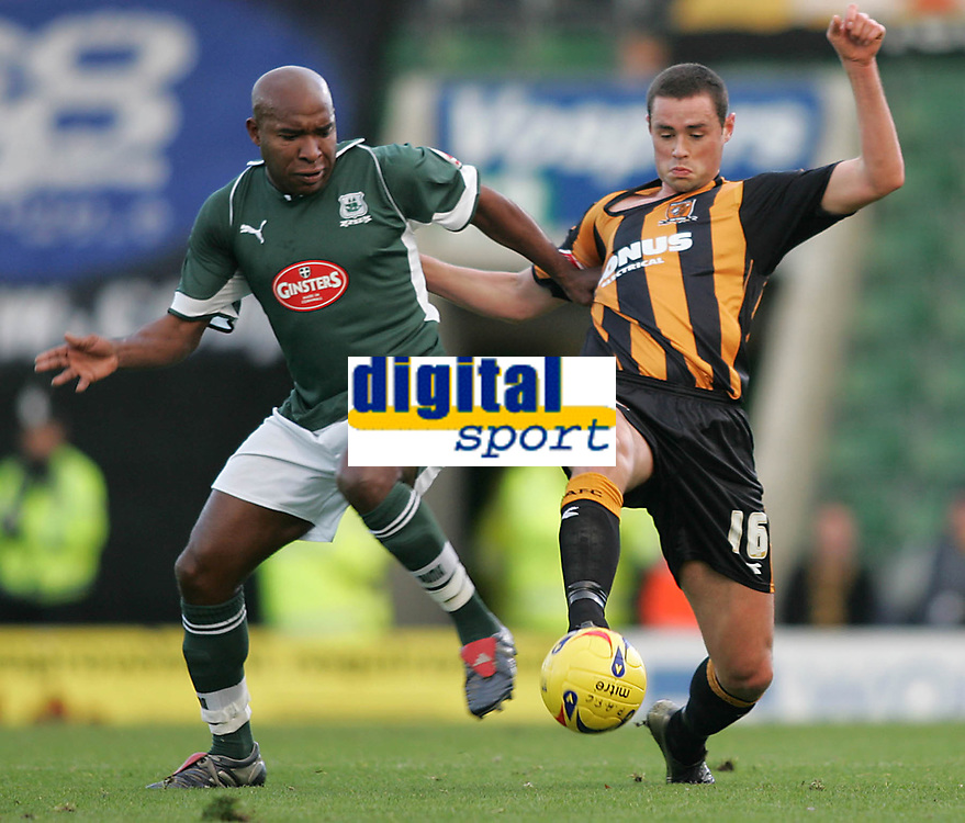 Photo: Lee Earle.<br /> Plymouth Argyle v Hull City. Coca Cola Championship. 09/12/2006. Hull's Damien Delaney (R) battles with Barry Hayles.
