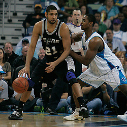 29 March 2009: San Antonio Spurs center Tim Duncan (21) is guarded by New Orleans Hornets center Hilton Armstrong (12) during a 90-86 victory by the New Orleans Hornets over Southwestern Division rivals the San Antonio Spurs at the New Orleans Arena in New Orleans, Louisiana.