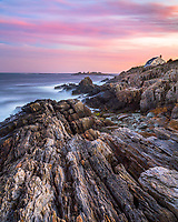 Soft pastels fill the sky above Giant's Stairs on Bailey Island. This is home of some of the most spectacular ocean scenery in Maine.
