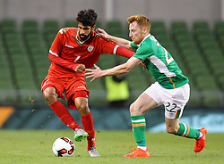 Omar Mohammed Rashid Al Malki in action against Ireland's Stephen Quinn - Mandatory by-line: Ken Sutton/JMP - 31/08/2016 - FOOTBALL - Aviva Stadium - Dublin,  - Republic of Ireland v Oman -