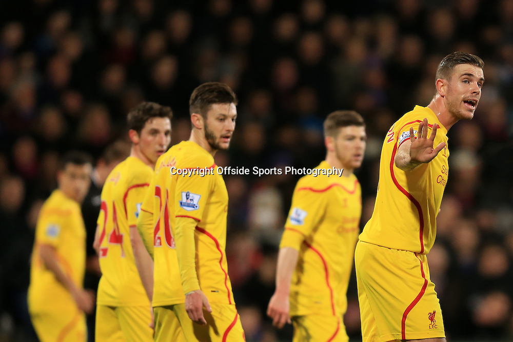14 February 2015 - The FA Cup Fifth Round - Crystal Palace v Liverpool - Jordan Henderson (R)  of Liverpool attempts to organise his team mates prior to a free kick being taken - Photo: Marc Atkins / Offside.