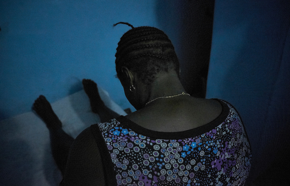 Sex worker Tour&eacute; at a brothel in Conakry, Guinea on March 19, 2016. MSF works in collaboration with partner Fraternit&eacute; M&eacute;dicale Guinea (FMG), an NGO that has developed strong ties in the community of sex workers. The NGO's work involves visits to sites of sex workers and counselling and referrals to medical centres in cases of health problems MSF launched a HIV testing campaign with FMG to reach this key population group. The program was undertaken in Conakry with the support of health authorities moving throughout several neighbourhoods throughout 2016. <br /> <br /> &quot;I've been working here for five years, I started working here because I had no other way of making a living. I decided to get involved in the awareness program because it's important to be aware of HIV and AIDS and it allowed me to pass on this message to the other women that I work with. There are women who come to me desperate because they are HIV positive. I can tel them that AIDS does not kill and that there is treatment these days. They are relieved when I tell them this. In general the community has a negative image of HIV, because I was trained I can give people the right information in the prevention of contracting HIV. My work is difficult, at the moment there is an economic crisis so there are not many clients. It's hard to make a living. It's high risk, we are victims of violence when clients become aggressive. I think it's important to continue with these campaigns and continue development in these types of programs.&quot;<br /> <br /> Despite countries in West and Central Africa having a relatively low HIV prevalence (