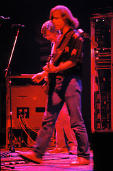 Bob Weir performing with the Grateful Dead in Concert at the Brendan Bryne Arena on April 1st 1988. Side view of Bob from stage left.