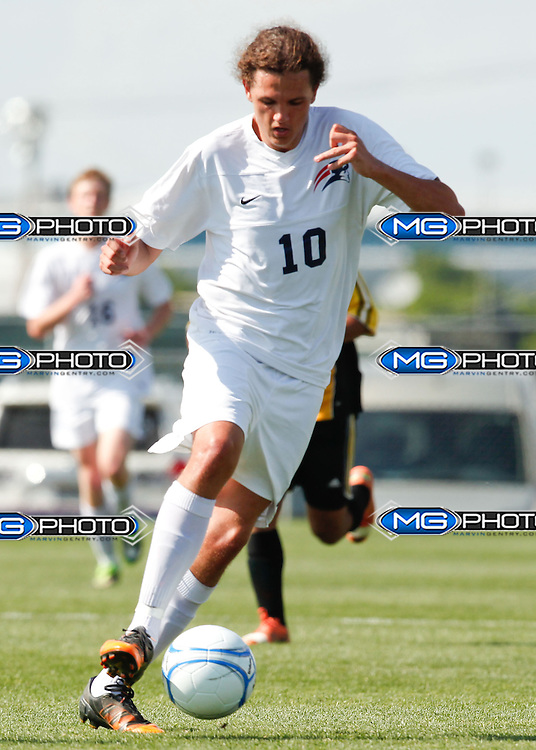 May 10, 2014; Huntsville, AL, USA;  Homewood Joseph Heeter (10) controls the ball during the 5A Boys State Soccer Championship at John Hunt Soccer Complex. Mandatory Credit: Marvin Gentry