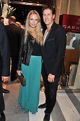 BRENDAN & ZOE COLE at a reception to unveil the ISAF World Match Racing Tour Championship Trophy at Garrard, 24 Albemarle Street, London W1 on 7th November 2011.