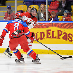WHITBY, - Dec 14, 2015 -  Game #4 - Russia vs. Canada East at the 2015 World Junior A Challenge at the Iroquois Park Recreation Complex, ON. Grant Cooper #10 of Team Canada East shoots the puck past Dmitrii Alekseev #8 of Team Russia during the second period.<br /> (Photo: Shawn Muir / OJHL Images)