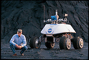 "Not long before going to Antarctica, William L. ""Red"" Whittaker took a rare moment off from his busy schedule to accompany Nomad, his meteorite-hunting robot, on a practice run. The robot spent Antarctica's summer of 2000 on the ice, hunting for meteorites. With its onboard instruments, Nomad found and classified five. It was the first time that a machine autonomously made a scientific discovery. Pittsburgh, PA. From the book Robo sapiens: Evolution of a New Species, page 138-139."