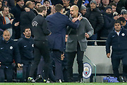 Manchester City manager Pep Guardiola with Tottenham Hotspur Manager Mauricio Pochettino at the end of the match during the Champions League Quarter-Final 1st leg between Tottenham Hotspur and Manchester City at Tottenham Hotspur Stadium, London, United Kingdom on 9 April 2019.