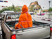 """12 NOVEMBER 2012 - BANGKOK, THAILAND:   A Buddha statue wrapped in saffron cloth before being delivered to a store on Bamrung Muang Street. Bamrung Muang Street in Bangkok. Thanon Bamrung Muang (Thanon is Thai for Road or Street) is Bangkok's """"Street of Many Buddhas."""" Like many ancient cities, Bangkok was once a city of artisan's neighborhoods and Bamrung Muang Road, near Bangkok's present day city hall, was once the street where all the country's Buddha statues were made. Now they made in factories on the edge of Bangkok, but Bamrung Muang Road is still where the statues are sold. Once an elephant trail, it was one of the first streets paved in Bangkok. It is the largest center of Buddhist supplies in Thailand. Not just statues but also monk's robes, candles, alms bowls, and pre-configured alms baskets are for sale along both sides of the street.    PHOTO BY JACK KURTZ"""