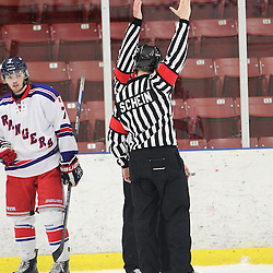 NORTH YORK, - Mar 23, 2016 -  Ontario Junior Hockey League game action between Georgetown Raiders and North York Rangers. Game 4 of the semi final playoff series. At the Herbert Carnegie Centennial Arena, ON. OHA Referee's make the call during the third period.<br /> (Photo by Tim Bates / OJHL Images)