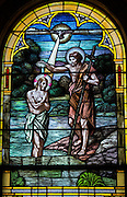 Stained glass image from St. Joseph Church in Kellnersville, Wis., depicts Jesus' baptism by his cousin John. (Sam Lucero photo)