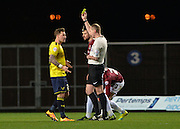 Oxford United Forward Chris Maguire is shown the yellow card during the Sky Bet League 2 match between Oxford United and Northampton Town at the Kassam Stadium, Oxford, England on 16 February 2016. Photo by Adam Rivers.