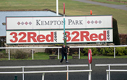 A member of ground staff prepares the track at Kempton Park Racecourse, Esher.