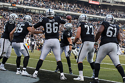 OAKLAND, CA - DECEMBER 09: Quarterback Derek Carr #4 of the Oakland Raiders celebrates with tight end Lee Smith #86 after after a touchdown against the Pittsburgh Steelers during the fourth quarter at O.co Coliseum on December 9, 2018 in Oakland, California. The Oakland Raiders defeated the Pittsburgh Steelers 24-21. (Photo by Jason O. Watson/Getty Images) *** Local Caption *** Derek Carr; Lee Smith